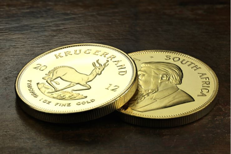 Krugerrand coins on a table - sell krugerrands