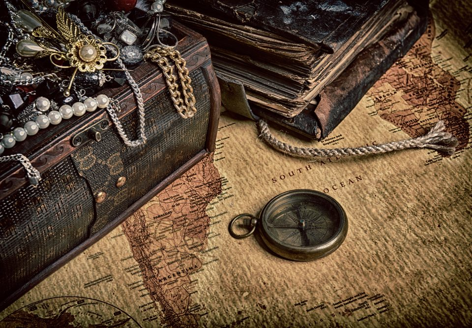 Selection of antique jewellery draped over a antique chest